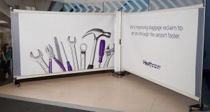 KwickScreen: portable, retractable infection control screens for your airport