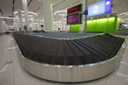 A baggage conveyor belt at Dubai International Airport.
